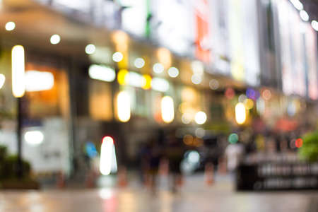 night life: abstract light blur shopping mall night life in city background Stock Photo