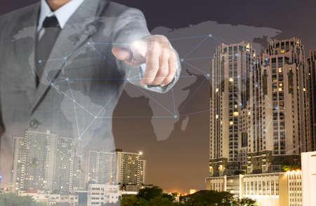 real world: double exposure business man with finger world network and real estate background Stock Photo