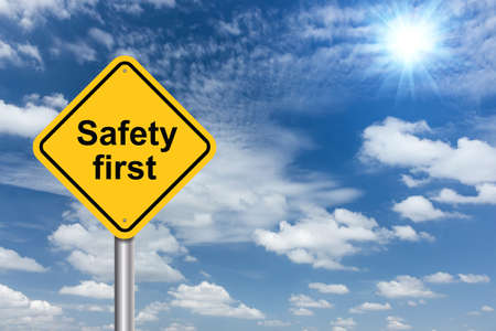 safety: safety first sign banner and clouds blue sky background