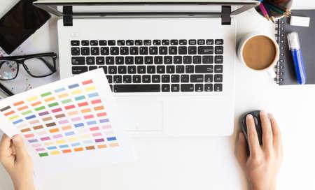 comp: closeup designer use laptop on desk workspace Stock Photo