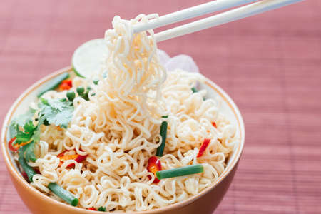 instant noodle: noodle with pepers spice in bowl asia culture food Stock Photo