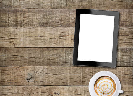 tablet white screen display and coffee on old wood background Imagens