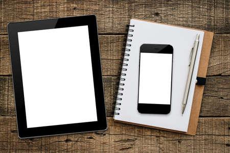 tablet en smartphone op hout achtergrond