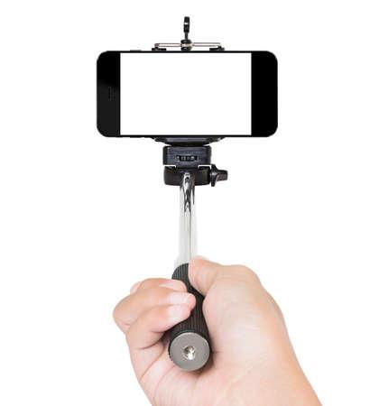 hand met selfie stok die witte het knippen weg binnen Stockfoto