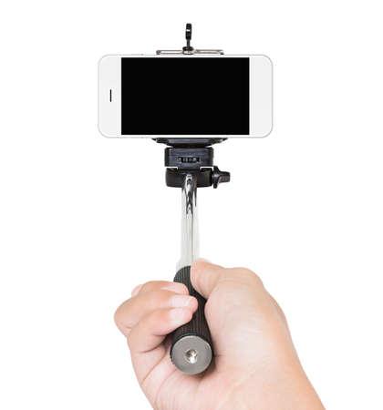 geïsoleerd hand holding selfie stok witte het knippen weg binnen