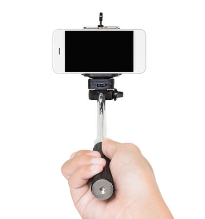 selfie: hand holding selfie stick isolated white clipping path inside Stock Photo