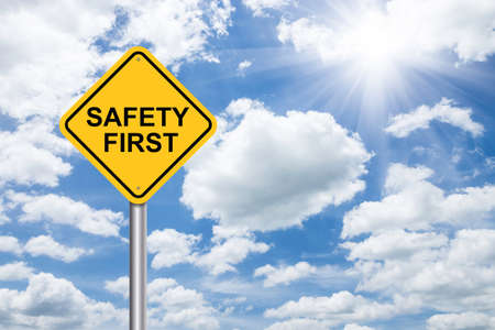 safety first sign on blue sky