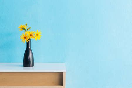 Jerusalem artichoke flower in vase on table interior design