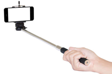 sticks: hand holding phone selfie stick isolated with clipping path Stock Photo