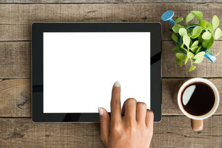 coffee table: hand using tablet on top view Stock Photo