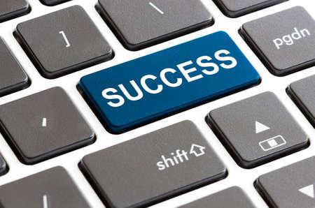 computer button: close up success button on keyboard computer