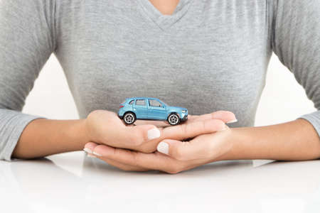 leasing: woman holding car model business leasing concept
