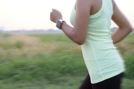 girl sport: women wear hand watch running motion blur conceptt Stock Photo