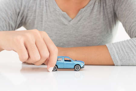 car leasing: women holding model car leasing business concept