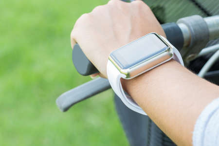 hand wear: closeup hand wear smart watch riding bicycle exercise sport