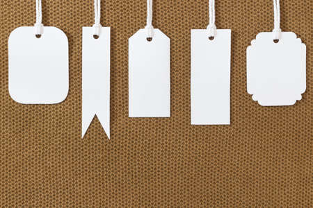label tag: white blank tags label on fabric texture Stock Photo