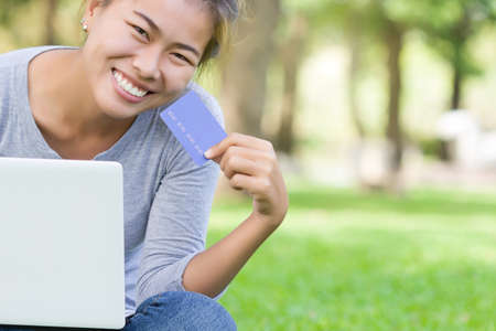 payments: happy woman with credit card and laptop new lifestyle easy payment shopping online