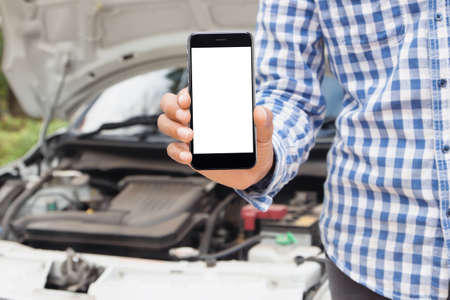 car breakdown: man showing phone blank screen call emergency service concept Stock Photo