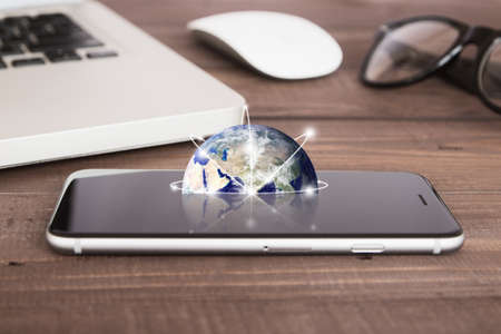 internet globe: earth on phone screen network concept elements Stock Photo