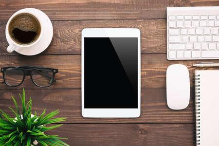 white work: white tablet blank screen on work desk