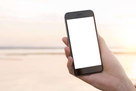 phone in female hand at outdoor Archivio Fotografico