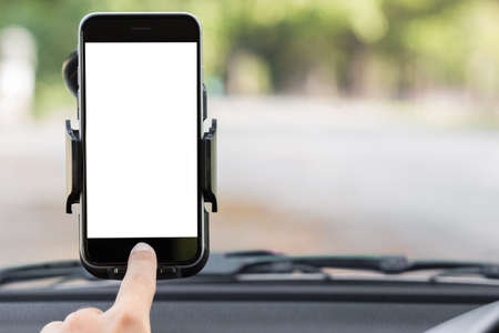 holders: close up hand use phone on mount in car
