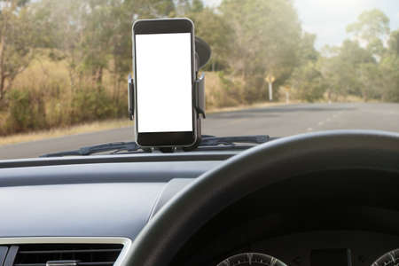 highway 6: phone and mounted holder in car on rural road Stock Photo