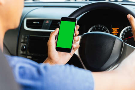 right on: man using maps app on phone in car, phone green screen easy for adjustment