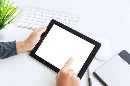 hand using digital tablet finger touch blank screen on desk work table 免版税图像 - 69175475