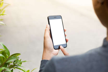 close-up phone mobile in woman hand holding and touch on blank screen, new modern people lifestyle Standard-Bild