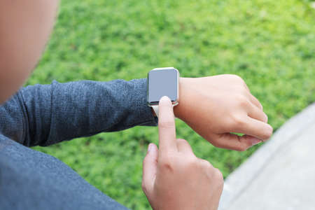 close-up on person hand wear smart watch new modern lifestyle