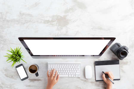 top view of creative photographer using graphic tablet on work table Stock Photo