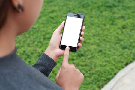 woman use phone white blank screen outdoor lifestyle