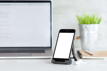 phone mobile showing white blank screen on work desk