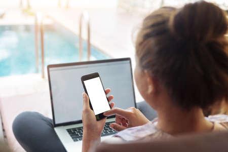 woman use phone mobile white screen at swiming pool