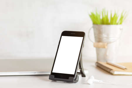 phone showing white blank screen on work desk