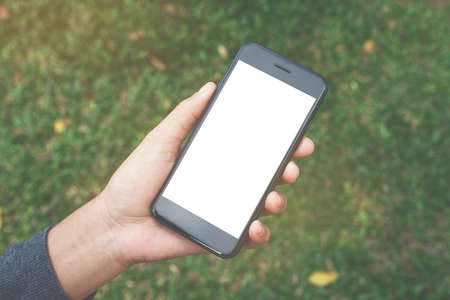close-up on hand hold phone showing white screen