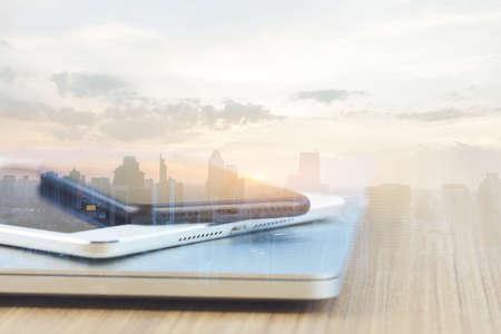 communication device stack on desk and city background reflect modern technology concept Stok Fotoğraf