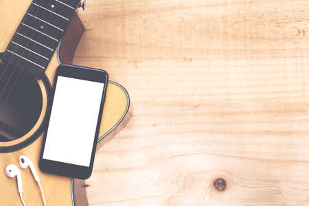 phone mobile showing screen on guitar top view music concept Stok Fotoğraf