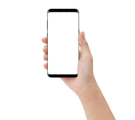 close-up hand touching phone mobile isolated on white, mock-up smartphone blank screen easy adjustment with clipping path Archivio Fotografico
