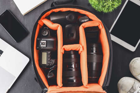 camera gear in bag on top view ready to go travel concept