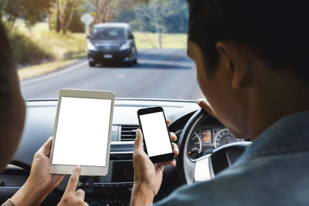 couple using phone inside car on rural road mobile app concept Stok Fotoğraf - 82676634