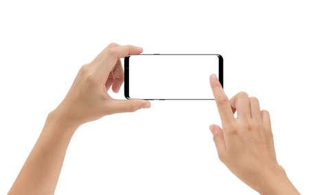 Smartphone van de handholding mobiel en wat betreft het scherm dat op witte achtergrond, cliping weg binnen wordt geïsoleerd Stockfoto