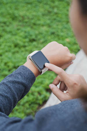 close-up woman using hand touching on smart watch Stok Fotoğraf - 84199905