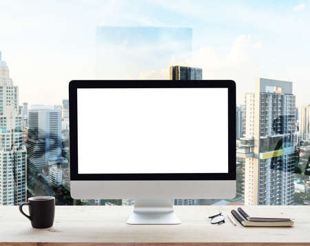 desktop computer white frame on work table in office place city background Stok Fotoğraf - 84789234