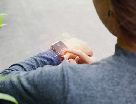 close-up woman using smart watch on hand showing infographic hologram Stok Fotoğraf - 85070319
