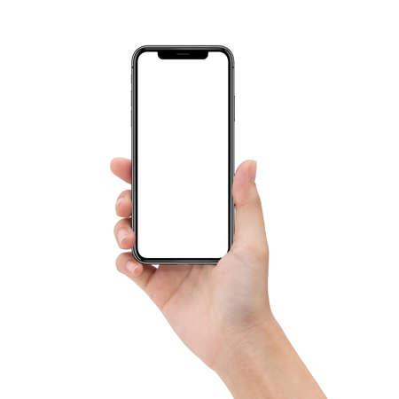 close-up vrouw hand met telefoon op tafel Stockfoto