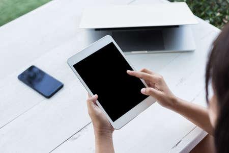 hand holding digital tablet finger point on screen