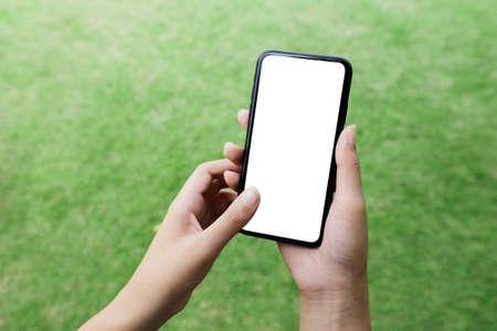 close-up women hand using smart phone white screen