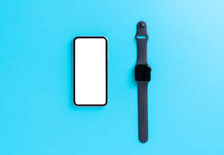 smartphone and smart watch on light blue background